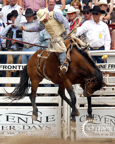 PRCA cowboy Dusty Hausauer scored an 82 point saddle bronc ride on the bronc War Chick during  the final round action at the 112th annual Cheyenne Frontier Days Rodeo in Cheyenne, Wyoming on July 27, 2008. Dusty's score of 241 points on three head was enough to win the championship buckle.