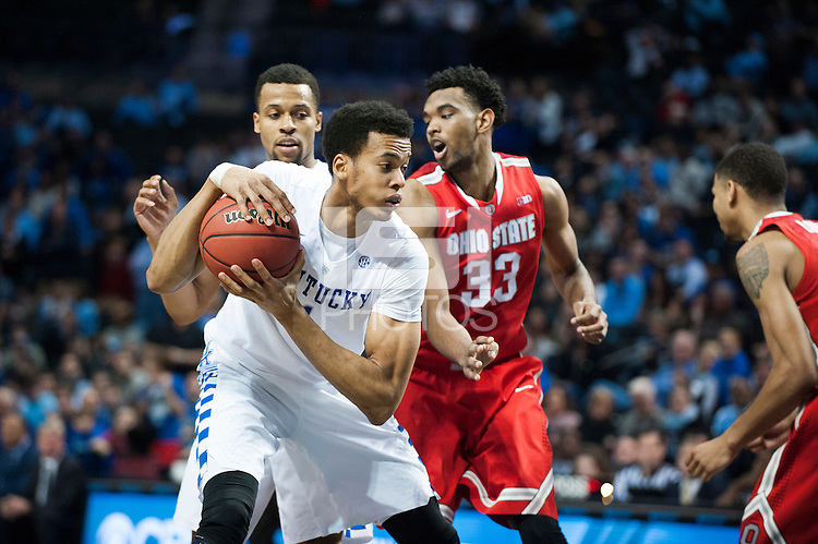 BROOKLYN, NY - Saturday December 19, 2015: Skal Labissiere (#1) of Kentucky keeps the ball from Keita Bates-Diop (#33) of Ohio State as the two teams square off in the CBS Classic at Barclays Center in Brooklyn, NY.