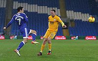 Peter Whittingham of Cardiff City crosses the ball into the box whilst under pressure from Aiden McGeady of Preston North End  during the Sky Bet Championship match between Cardiff City and Preston North End at Cardiff City Stadium, Wales, UK. Tuesday 31 January 2017