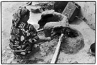 Uzbekistan - Ferghana Valley - A beduin woman cooking in her open air kitchen.