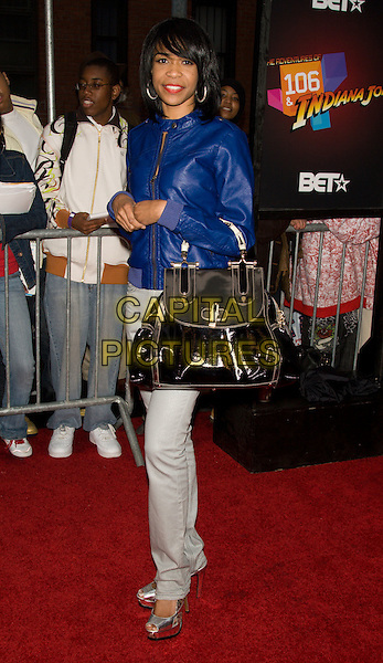 """MICHELLE WILLIAMS.Premiere of """"Indiana Jones and the Kingdom of the Crystal Skull"""" in Harlem.at the AMC Magic Johnson Theaters, Harlem, NY, USA..May 20th, 2008 .full length platform silver shoes white jeans denim blue leather jacket patent black bag purse .CAP/LNC/TOM.©TOM/LNC/Capital Pictures."""