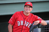 Infielder Hector Lorenzana of the Greenville Drive waits for the start of a game against the Charleston RiverDogs on Friday, August 14, 2015, at Fluor Field at the West End in Greenville, South Carolina. Charleston won 6-2. (Tom Priddy/Four Seam Images)
