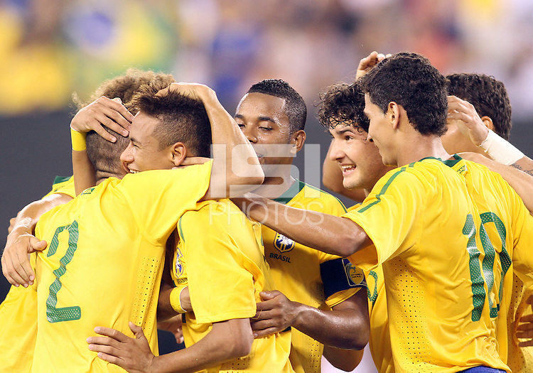 Neymar #11 of Brazil  is congratulated after scoring the first goal during an international friendly match against the USA in Giants Stadium, on August 10 2010, in East Rutherford, New Jersey. brazil won 2-0.