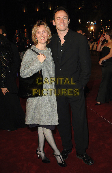 """JASON ISAACS & GUEST.The world premiere of """"Casino Royale"""", Odeon Leicester Square, London, England..November 14th, 2007.james bond 007 full length black suit bag purse grey gray coat .CAP/BEL.©Belcher/Capital Pictures"""
