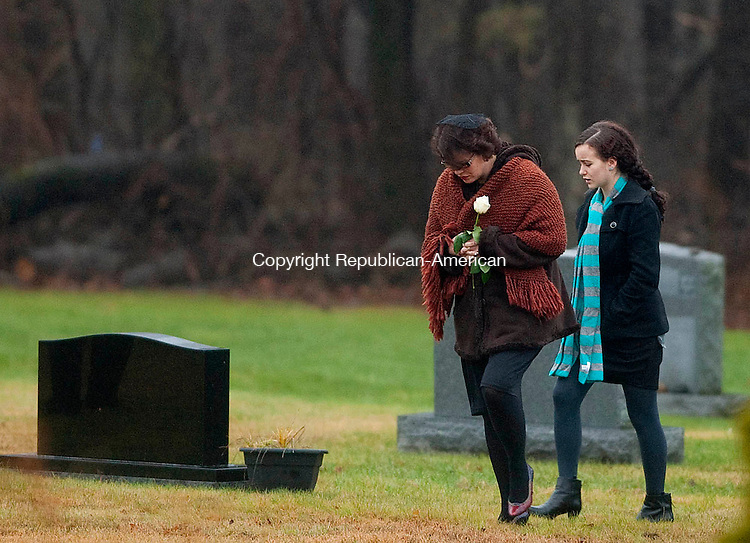 MONROE, CT 17 DECEMBER- 121712JS05- Veronique Pozner, makes her way to the gravesite with a family member Monday at the funeral of her son Noah Pozner, 6, the youngest victim of the shooting Friday at Sandy Hook Elementary School in Newtown.  Noah was laid to rest at B'nai Israel Cemetery on Moose Hill Road in Monroe. Memorial contributions may be directed to the planting of trees in Israel. .Jim Shannon Republican American