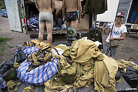 "Actors get undressed in front of the costume truck at the end of the day's filming of ""The Last Prince"" television series at Hengdian World Studios near Hengdian July 23, 2015. Extras and actors with smaller roles often take care of their own costumes and play more than one character in this production about the war against Japan. Director Li Xiaoqiang said the series is about a Qing Dynasty prince, who joined the Chinese nationalist army after suffering family misfortune. ""After he learnt more about the Communist Party, the prince began to understand what real revolution and the anti-Japanese war meant, and turned to the Communist Party to fight Japan"", the director added. According to local media, more than 10 new movies, 12 TV dramas, 20 documentaries and 183 war-themed stage performances will be released in China to coincide with the 70th anniversary of the end of World War Two. REUTERS/Damir SagoljPICTURE 26 OF 28 FOR WIDER IMAGE STORY ""BEHIND THE SCENES OF A CHINESE WAR DRAMA"".SEARCH ""SAGOLJ STUDIO"" FOR ALL PICTURES."