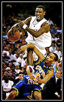 University of Texas freshman point guard Daniel Gibson (top) gets tangled up with Coppin State defender Daryl Roberts during the game at the Erwin Center in Austin, Texas on November 29, 2004.  Gibson scored 17 points on the night to propel the Longhorns to an 86-50 victory over Coppin State. (Brian Ray for The Daily Texan)