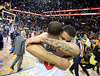 ANDREW SHURTLEFF/THE DAILY PROGRESS<br /> Virginia seniors Isaiah Wilkins (right) and Devon Hall (left) embrace after defeating North Carolina 71-63 to become ACC Tournament champions Saturday in Brooklyn, NY.