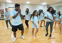 NWA Democrat-Gazette/BEN GOFF @NWABENGOFF<br /> JaQuan Farr (from left), Leslie Olvera and Geonna Johnson, students in the Dance 4 class, rehearse Thursday, Sept. 6, 2018, for an upcoming performance at Rogers High School. The school's dance classes are working on routines for the Back to School Kermes latin food festival, from 12:00 p.m. to 4:00 p.m. Sunday in the school's courtyard. The public event is a fundraiser for the school's dance program.