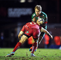 Matthew Tait of Leicester Tigers is tackled by Hadleigh Parkes of the Scarlets. European Rugby Champions Cup match, between Leicester Tigers and the Scarlets on January 16, 2015 at Welford Road in Leicester, England. Photo by: Patrick Khachfe / JMP
