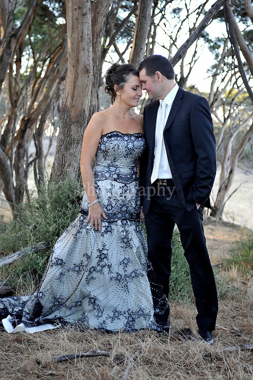 This beautiful  wedding was photographed  at Dudley Wines on Kangaroo Island the most beautiful back drop over looking across to back stairs passage  to the mainland.