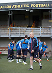 Rangers team arrives at Alloa's Indodrill Stadium to train on their synthetic surface ahead of the match on Sunday, manager Mark Warburton on the pitch