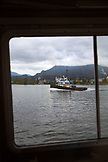 CANADA, Vancouver, British Columbia, a tugboat cruises along in the Vancouver Harbor