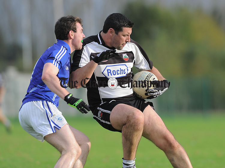Patrick Sheehan of Cratloe in action against Eoin Brennan of Clarecastle during their Junior B county football final in Shannon. Photograph by John Kelly.