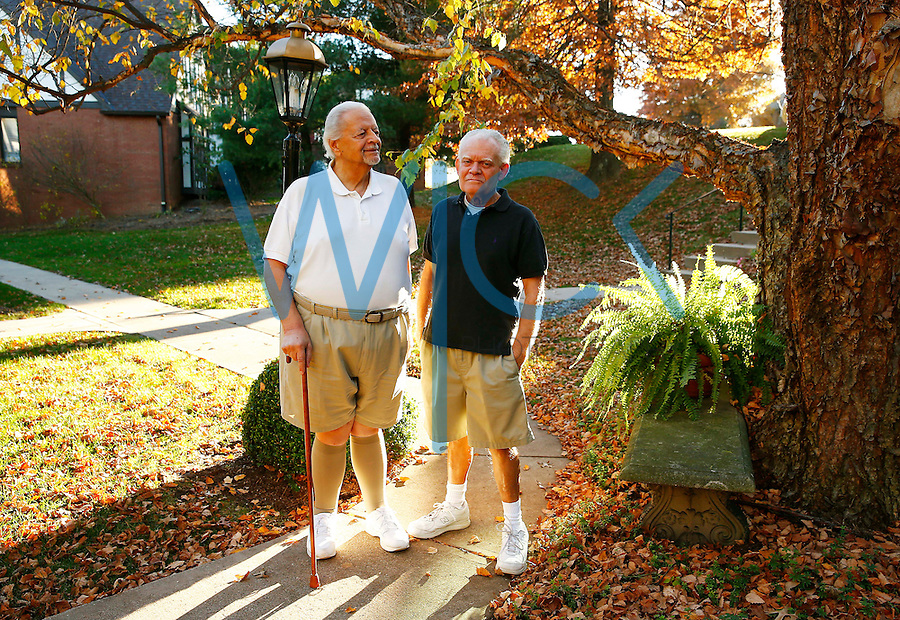 Nino Esposito (left) and Drew Bosee (right) pose for a portrait at their home in Pittsburgh, Pennsylvania on November 3, 2015. (Photo by Jared Wickerham/For The New York Daily News)
