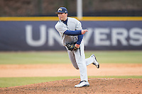UNCG Spartans relief pitcher Cody Fitch (14) follows through on his delivery against the High Point Panthers at Willard Stadium on February 14, 2015 in High Point, North Carolina.  The Panthers defeated the Spartans 12-2.  (Brian Westerholt/Four Seam Images)