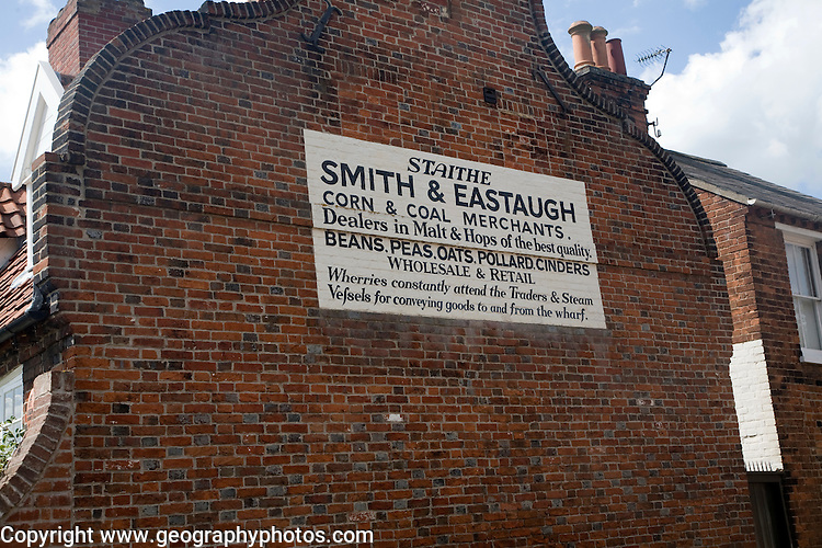 Coal and corn merchant sign on side of building, Beccles, Suffolk, England