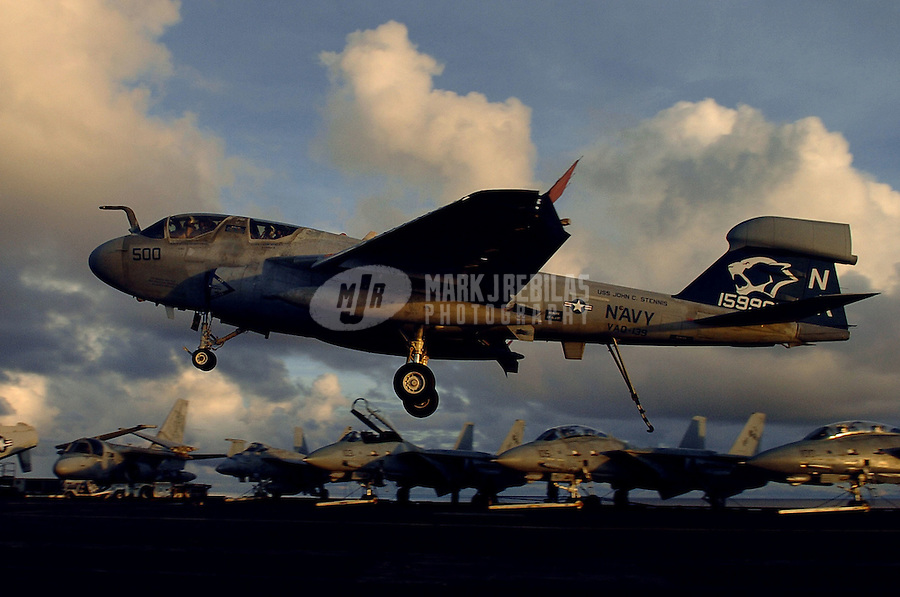 """041019-N-6213R-032 Pacific Ocean (Oct. 19, 2004) - An EA-6B Prowler from the """"Cougars"""" of Tactical Electronic Warfare Squadron One Three Nine (VAQ-139) lands on the flight deck aboard USS John C. Stennis (CVN 74). Stennis and embarked Carrier Air Wing Fourteen (CVW-14) are at sea on a scheduled deployment to the Western Pacific Ocean. Photo by Mark J. Rebilas"""