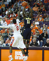 Nov 30, 2010; Clemson, SC, USA; Michigan Wolverines guard Tim Hardaway, Jr. (10) shoots a three over Clemson guard Demontez Stitt (2) in the game against the Clemson Tigers at Littlejohn Coliseum. Mandatory Credit: Daniel Shirey/WM Photo -US PRESSWIRE