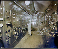BNPS.co.uk (01202 558833)<br /> Pic:    CanterburyAuctionGalleries/BNPS<br /> <br /> The engine room on board the SS Normandie.<br /> <br /> Remarkable photos of the iconic ocean liner SS Normandie which was like a 'floating palace' have come to light over 80 years later.<br /> <br /> The giant 1,000ft long French passenger ship was the largest of her type in the world and won the coveted 'Blue Riband' for the fastest crossing of the Atlantic.<br /> <br /> English photographer Percy Byron's photos show the liner's luxurious 'Art Deco' interior with its chandeliers and pillars of Lalique glass.<br /> <br /> The vessel, which launched in 1935, even boasted its own swimming pool and a gym where young women can be seen doing aerobics while a man in a suit trains with a punch bag.