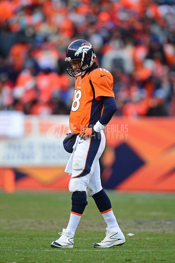 Jan 12, 2013; Denver, CO, USA; Denver Broncos quarterback Peyton Manning (18) against the Baltimore Ravens during the AFC divisional round playoff game at Sports Authority Field.  Mandatory Credit: Mark J. Rebilas-