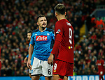 Mario Rui of Napoli exchanges words with Roberto Firmino of Liverpool during the UEFA Champions League match at Anfield, Liverpool. Picture date: 27th November 2019. Picture credit should read: Andrew Yates/Sportimage