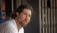 New York Mets Pitcher R.A. Dickey rests inside of the dugout after been replaced by Jon Rauch during their game against Miami Marlins at Citi Field Stadium in New York. Photo by Eduardo Munoz Alvarez / VIEW.