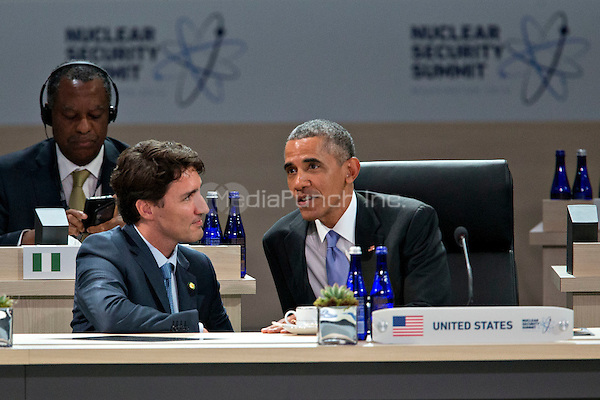 United States President Barack Obama, right, talks to Justin Trudeau, Canada's prime minister, during a closing session at the Nuclear Security Summit in Washington, D.C., U.S., on Friday, April 1, 2016. After a spate of terrorist attacks from Europe to Africa, Obama is rallying international support during the summit for an effort to keep Islamic State and similar groups from obtaining nuclear material and other weapons of mass destruction. <br /> Credit: Andrew Harrer / Pool via CNP/MediaPunch