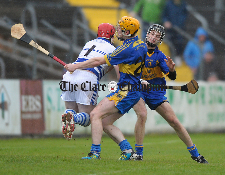 Sean Hawes of Cratloe in action against James Liddy and Shane O Brien of Newmarket On Fergus during the senior county hurling final at Cusack Park. Photograph by John Kelly.