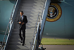 President Barack Obama walks off Air Force One in Tampa.