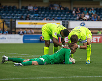 Goalkeeper Sam Walker of Colchester United gets congratulated for making another fine save during the Sky Bet League 2 match between Wycombe Wanderers and Colchester United at Adams Park, High Wycombe, England on 27 August 2016. Photo by Liam McAvoy.