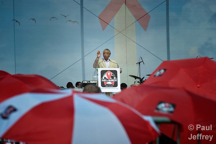 The Rev. Al Sharpton addresses a rally on the Capital Mall in Washington on July 22, 2012, to demand that the U.S. and other governments keep their promises to fund global relief programs for those living with HIV and AIDS. The rally took place as more than 23,000 delegates gathered in the US capital city for the XIX International AIDS Conference.