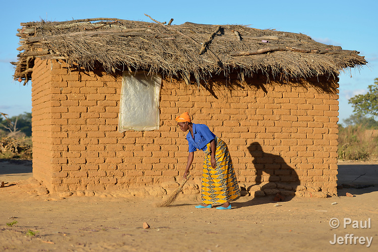 Frances Mtonga sweeps around her house in Chibamu Jere, Malawi. Pregnant for the third time, Mtonga and other women in the village get support from the Maternal, Newborn and Child Health program of the Livingstonia Synod of the Church of Central Africa Presbyterian. Her husband works in South Africa and sends home money to support her and her children.
