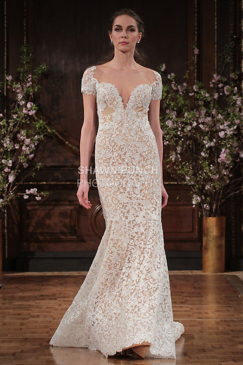 """Model walks runway in a """"Glenn"""" bridal gown from the Isabelle Armstrong Spring Collection 2017, at Lotte New York Palace Hotel, during New York Bridal Fashion Week Spring Summer 2017 on April 16, 2017."""
