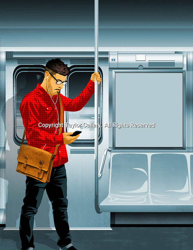 Young man standing inside train