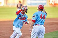 Peoria Chiefs right fielder Wadye Ynfante (3) is congratulated by manager Erick Almonte (44) after hitting a home run during a Midwest League game against the Bowling Green Hot Rods at Dozer Park on May 5, 2019 in Peoria, Illinois. Peoria defeated Bowling Green 11-3. (Zachary Lucy/Four Seam Images)