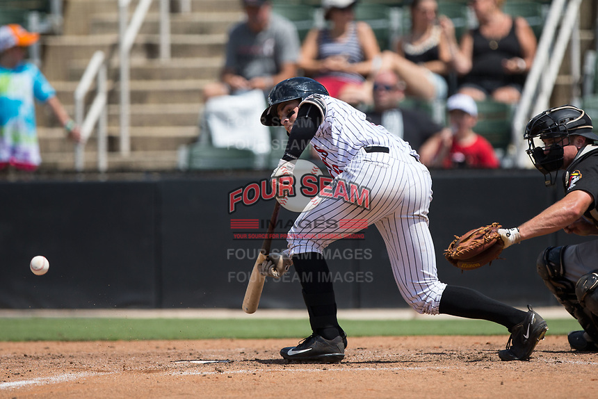 Mitch Roman (10) of the Kannapolis Intimidators lays down a bunt during the game against the West Virginia Power at Kannapolis Intimidators Stadium on June 18, 2017 in Kannapolis, North Carolina.  The Intimidators defeated the Power 5-3 to win the South Atlantic League Northern Division first half title.  It is the first trip to the playoffs for the Intimidators since 2009.  (Brian Westerholt/Four Seam Images)