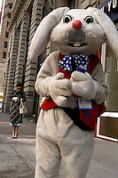 Richard J. Concepcion, a.k.a. Rapid T. Rabbit, waits for a bus in midtown Manhattan.   Furries are a group of people who identify themselves not as being human but as a walking, talking animal.  For some the lifestyle is complete, animal traits reach into every aspect of life from mundane trips to a grocery store to sexual fantasies.  For others, involvement in the furry fandom is limited to public performances and meet-and-greets.