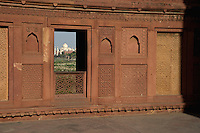 Agra Fort is a UNESCO World Heritage site located in Agra, India. The fort is also known as Lal Qila, Fort Rouge and Red Fort of Agra. It is about 2.5 km northwest of its much more famous sister monument, the Taj Mahal. The fort can be more accurately described as a walled palatial city...It is the most important fort in India. The great Mughals Babur, Humayun, Akbar, Jehangir, Shah Jahan and Aurangzeb lived here, and the country was governed from here. It contained the largest state treasury and mint. It was visited by foreign ambassadors, travellers and the highest dignitaries who participated in the making of history in India..