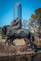 The Centennial Land Run Monument in Oklahoma City Oklahoma is located in the Bricktown Distict.  The bronze sculpture is the work of Paul Moore and features 45 pices including land run participants, horses, wagons and more frozen in a moment in time.<br /> <br /> The monument is the larges freestanding bronze sculptures in the world spanning 365 feet in length and 36 fee wide at a hight of nearly 16 feet.