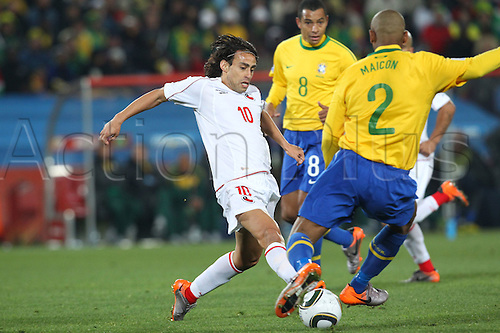 JUNE 28, 2010 - Football : 2010 FIFA World Cup South Africa Round of 16 between Brazil 3-0 Chile at Ellis Park Stadium, Johannesburg, South Africa.Jorge Valdivia (CHI) takes on Maicon of Brazil.