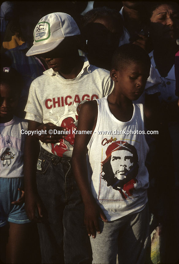 A young boy wears a Che Guevara shirt while waiting for Pope John Paul II's arrival in the Plaza de la Revolution in 1998.