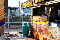 A gas tank sits outside a fast food kiosk at the carnival at St. Peter's Fiesta in Gloucester, Massachusetts, USA.
