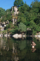 A young boy prepares for a swim in the Ardeche river in the dramatic setting of this limestone gorge