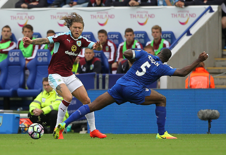 Burnley's Jeff Hendrick and Leicester City's Wes Morgan in action during todays match  <br /> <br /> Photographer Rachel Holborn/CameraSport<br /> <br /> The Premier League - Leicester City v Burnley - Saturday 17th September 2016 - King Power Stadium - Leicester <br /> <br /> World Copyright &copy; 2016 CameraSport. All rights reserved. 43 Linden Ave. Countesthorpe. Leicester. England. LE8 5PG - Tel: +44 (0) 116 277 4147 - admin@camerasport.com - www.camerasport.com
