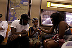 A family on the A Train commuting through Harlem on June 23, 2012.