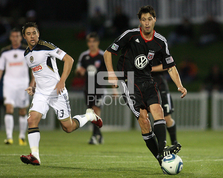 Branko Boskovic(8) of D.C. United passes ahead of Kyle Nakazawa(13) of the Philadelphia Union during a play-in game for the US Open Cup tournament at Maryland Sportsplex, in Boyds, Maryland on April 6 2011. D.C. United won 3-2 after overtime penalty kicks.