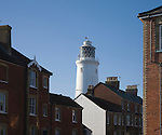 White lighthouse standing against winter blue sky in the town of Southwold, Suffolk, England