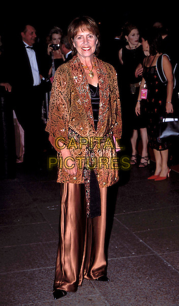 "PENELOPE WILTON.at the ""Calendar Girls"" Premiere, Leicester Square.brown silk trousers, satin, brown printed cardigan, wrap around, asian style, full length, full-length.www.capitalpictures.com.sales@capitalpictures.com.© Capital Pictures"