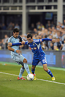 Andrea Romero (15) forward Montreal Impact holds off Benny Feilhaber (10) midfield Sporting KC ..Sporting Kansas City defeated Montreal Impact 2-0 at Sporting Park, Kansas City, Kansas.